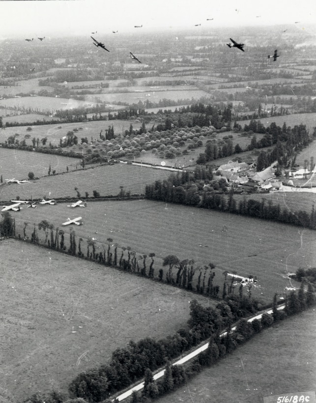 C-47s bank for England after their CG-4A gliders have cut loose from their tow lines. (U.S. Air Force photo)