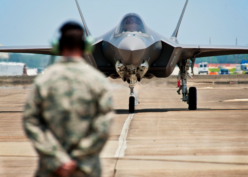 F-35 Lightning II joint strike fighter crew chief, Tech. Sgt. Brian West, watches his aircraft approach for the first time at Eglin Air Force Base, Fla., July 14.  Aircraft 0747 is DoD's newest aircraft.  (U.S. Air Force photo/Samuel King Jr.)