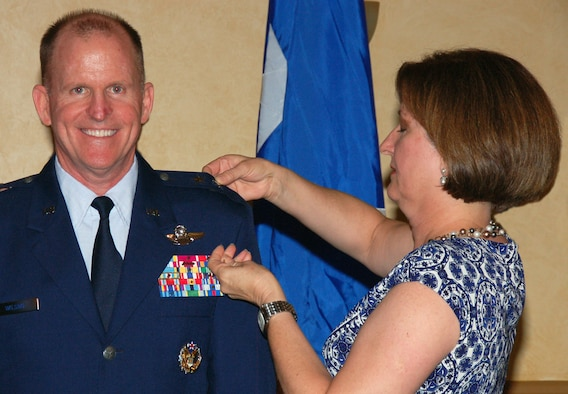 BARKSDALE AIR FORCE BASE, La. - Nancy Wilson pins the second star on Maj. Gen. Stephen Wilson, Eighth Air Force commander, during his promotion ceremony at the Barksdale Club July 15. General Wilson was frocked to the rank of major general. Frocking is a term for a commissioned officer selected for promotion which allows them to wear the insignia of the higher grade before the official date of promotion. (U.S. Air Force photo by Staff Sgt. Brian Stives)