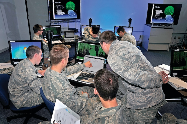 Upperclass Cadets at the U.S. Air Force Academy have the opportunity to spend one of their summer sessions in Cyber 256, Basic Cyber Operations, a new course that rounds out the training regimen designed to fit the Air Force mission of fighting and winning in air, space and cyberspace. The course is intended to spark cadets' interest in pursuing more in-depth work in computer science.    (U.S. Air Force Photo/Raymond McCoy)