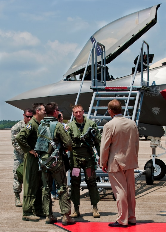 Lt. Col. Eric Smith, of the 58th Fighter Squadron, talks with his squadron and wing commanders after piloting the first F-35 Lightning II joint strike fighter to its new home at Eglin Air Force Base, Fla., July 14. (U.S. Air Force photo/Samuel King Jr.)