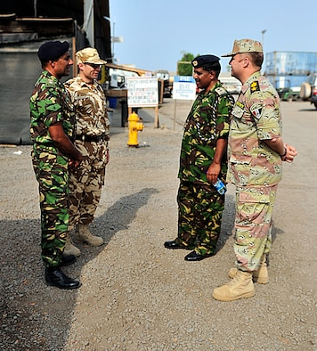 CAMP LEMONNIER, Djibouti – Kenyan Ministry of Defense Muslim Imam (Lieutenant Colonel) Mohammed Ahmed (second from the right) meets with partner nation coalition officers from Combined Joint Task Force - Horn of Africa (CJTF-HOA) before visiting the Muslim prayer tent on Camp Lemonnier, July 5. Ahmed, along with two other Kenyan chaplains, traveled to Camp Lemonnier to receive U.S. professional military chaplaincy familiarization with CJTF-HOA chaplains. (U.S. Army photo by Specialist Michelle C. Lawrence)