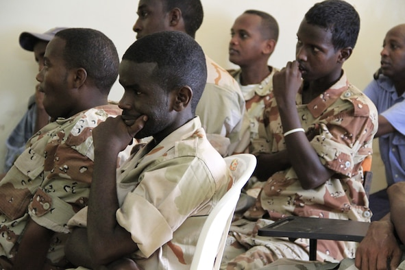 DJIBOUTI CITY, Djibouti - Djiboutian military medical students listen to a presentation on medical best practices, July 5. Members from Combined Joint Task Force-Horn of Africa partnered with the Djiboutian Ministry of Defense Health Services in a week-long seminar to share medical best practices. This information exchange between the two partner nations has occurred for nearly a decade. (U.S. Air Force photo by Capt. Jennifer Pearson)
