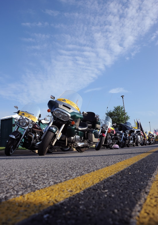 A group of Patriot Guard motorcycles await their riders at the Joint Base Andrews Motorcycle Safety Day on July 15.  Servicemembers from all branches, civilian DoD employees and civilians were invited to the event which focused on promoting safe riding during the peak season.