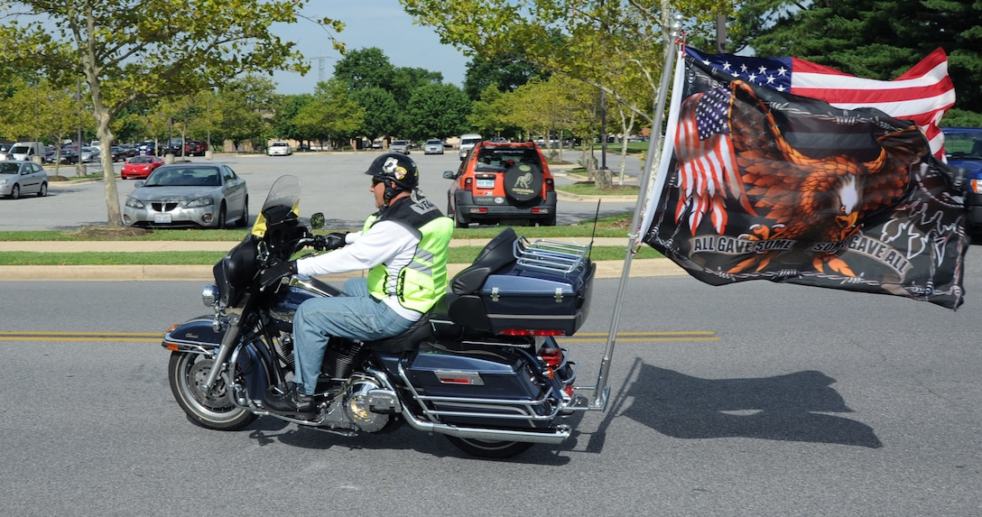 A member of the Patriot Guard departs on the group ride at the Joint Base Andrews Motorcycle Safety Day here July 15.  The event was part of and Air Force-wide effort to educate riders and minimize accidents. (U.S. Air Force photo by Senior Airman Torey Griffith)