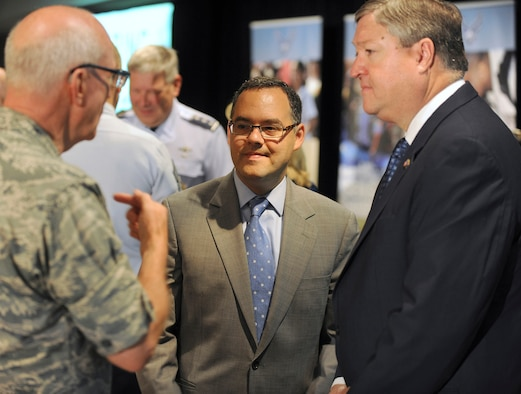 Secretary of the Air Force Michael Donley (right) and Assistant Secretary of the Air Force for Manpower and Reserve Affairs Daniel Ginsberg visit with Maj. Gen. Cecil Richardson, Air Force chief of chaplains, during the Caring for People forum July 19, 2011, in Arlington, Va. Donley made the opening remarks for the three-day event. (U.S. Air Force photo/Scott M. Ash)