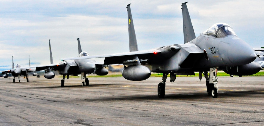 Several Japanese F-15 Eagle fighter aircraft taxi out July 15, 2011, Eielson Air Force Base, Alaska.  Thorough planning and precautions have ensured challenges were overcome and the immediate participation of six of Japan's F-15s upon arrival at RF-A 11-2. (U.S. Air Force photo by/Staff Sgt. Miguel Lara)
