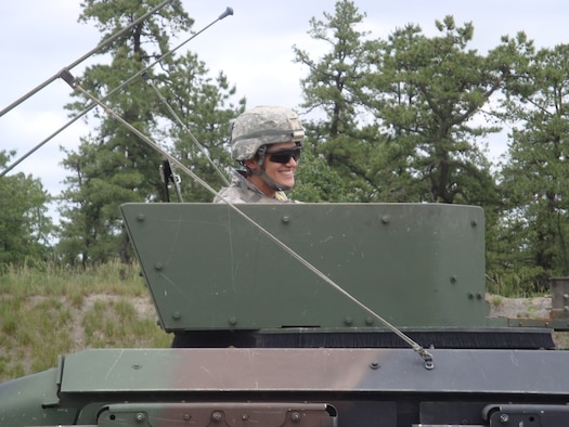 """Master Sgt. Ireli """"Eydee"""" Hinger, 33rd Network Warfare Squadron's Air Force Computer Emergency Response Team operations superintendent, qualifies on the .50-caliber machine gun in an up-armored humvee during training at Fort Dix, N.J., in 2010. Hinger is a weapons specialist with expert qualifications in the M-16 rifle, M-4 carbine, M-240B machine gun and the M-249 Squad Automatic Weapon. She has been submitted by Air Force Space Command as a nominee for Marie Claire's annual issue honoring young women across various industries who have made significant contributions in their fields. (Courtesy photo)"""