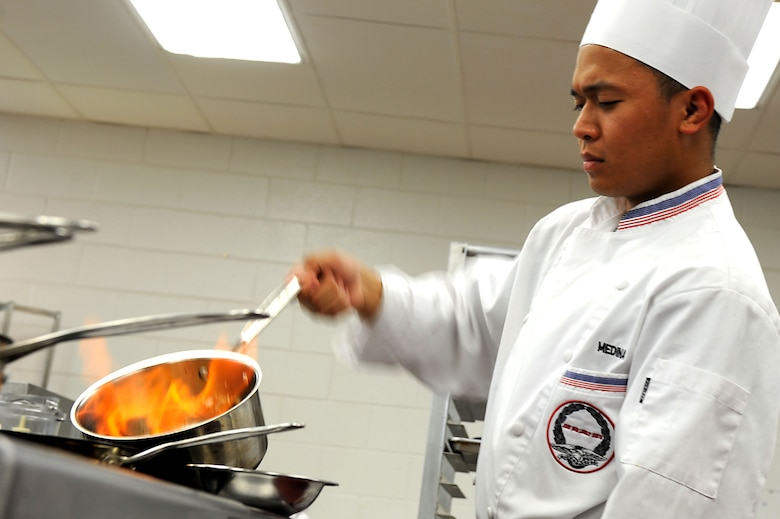 Staff Sgt. Ghil Medina, 633rd Force Support Squadron services journeyman, practices perfecting the preparation of his competition dish at Fort Lee, Va., July 13, 2011. Sergeant Medina has won numerous awards in the military food services community including being the first Airman to win the 2011 Armed Forces Junior Chef of the Year Award. (U.S. Air Force photo by Airman 1st Class Kayla Newman/Released)