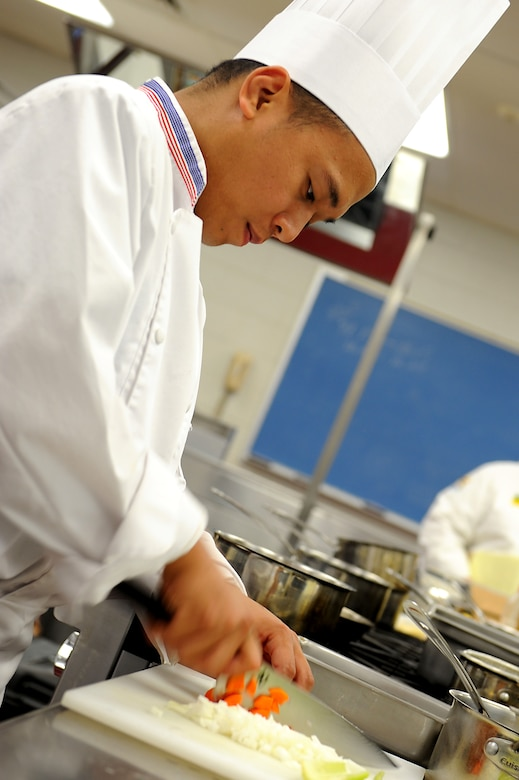 Staff Sgt. Ghil Medina, 633rd Force Support Squadron services journeyman, adds vegetables to his competition dish during training at Fort Lee, Va., July 13, 2011. Sergeant Medina will compete for the distinction of becoming the American Culinary Federation's National Student Chef of the Year Award at the 2011 ACF National Convention in Dallas.  (U.S. Air Force photo by Airman 1st Class Kayla Newman/Released)
