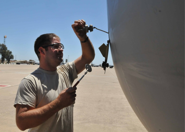 Tech. Sgt. Ryan K. Sandell checks the engine oil on a KC-135 Stratotanker while deployed with the 313th Air Expeditionary Wing in Western Europe on July 18, 2011. (U.S. Air Force photo/Capt. John P. Capra)