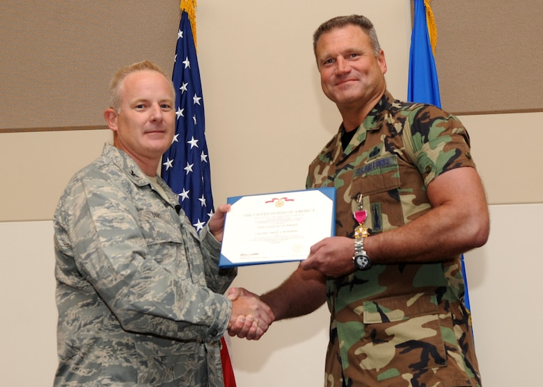 BUCKLEY AIR FORCE BASE, Colo. --  Colonel Daniel Dant, 460th Space Wing commander, awards the Legion of Merit to Col. Trent Pickering, 460th Space Wing vice commander July 15, 2011. After serving as the wing's vice commander for 2 years, Pickering will be moving on to the National Reconnaissance Office in Chantilly, Va. (U.S. Air Force photo by Airman1st Class Marcy Glass)