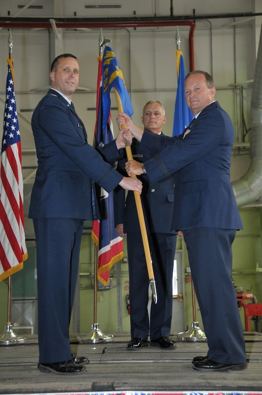 Col. Stephen E. Rader (left) assumes command of the 153rd Airlift Wing, Wyoming Air National Guard, July 9, 2011. Brig. Gen. Donald A. Haught (right), Assistant Adjutant General-Air, Wyoming National Guard, was the presiding officer of the ceremony. Haught presents the unit flag to Rader as a symbolic gesture in front of the entire unit in order for all who attend to witness their new leader assume his dutiful position.(U.S. Air Force photo by Master Sgt. Paul Mann)(Released)