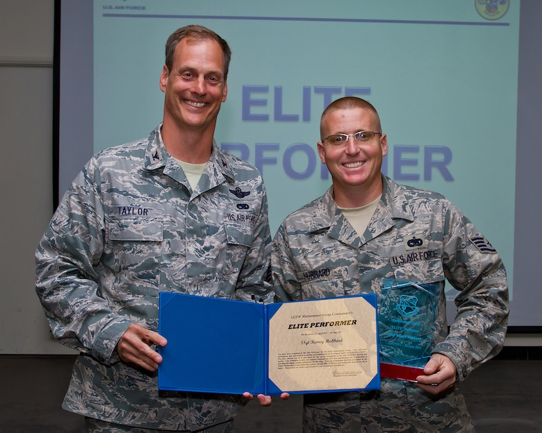 Col. James Taylor (left) presents Staff Sgt. Ramey Hubbard the Elite Performers Award for his work with the Component Maintenance Flight. (U.S. Air Force photo/Senior Airman Chris Heising)