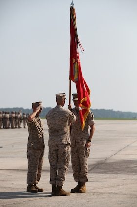 Colonel Michael Cederholm, the Marine Aircraft Group 31 commanding officer, and Col. David Robinson, the outgoing MAG-31 commanding officer, recieves the Marine Corps colors in front of the Marines from the multiple Marine Corps F/A-18 squadrons July 22, aboard Fightertown.  Cederholm takes control of a full house with all of the squadrons currently in garrison, which is a rare occurrence with the rapid training and deployment schedule.