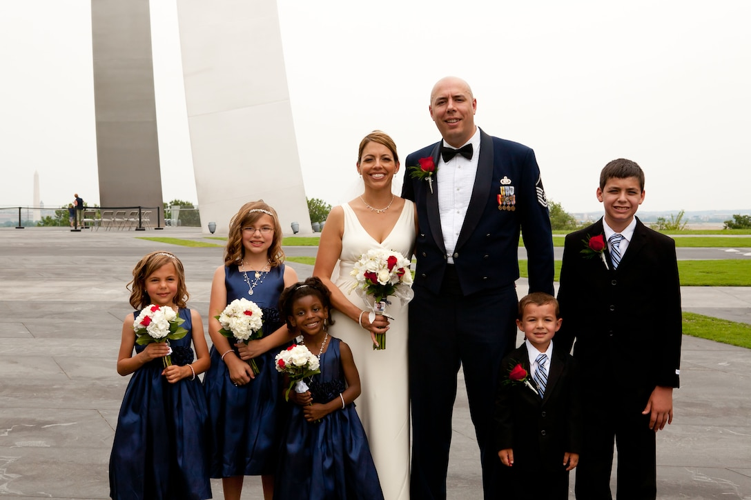 Master Sgt. Christopher Sweet and Danielle Balmer  pose for pictures with their new family July 4th at the Air Force Memorial in Washington, D.C. (Photo courtesy of Hans and Nicole Photography)