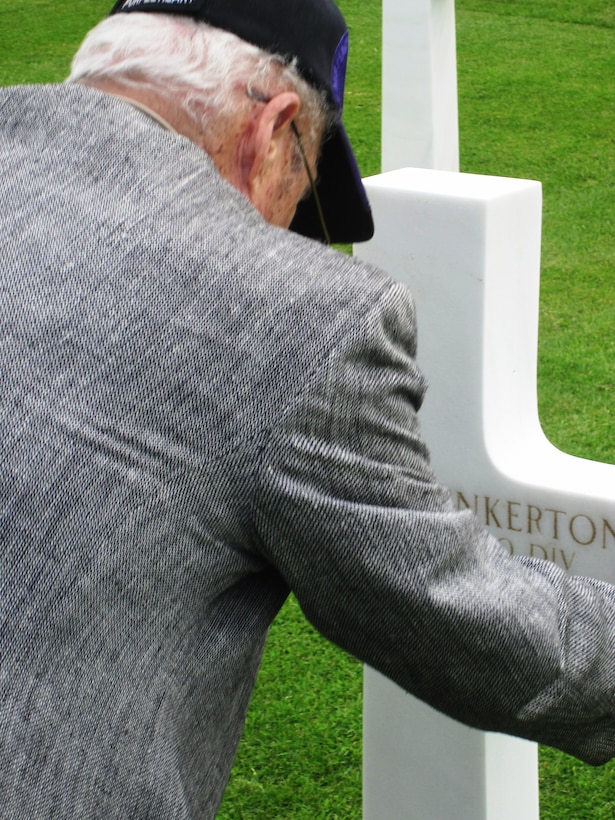 CAMBRIDGE AMERICAN CEMETERY, England - James Pinkerton, 87-year-old Purple Heart veteran of World War II, visits his brother's grave at Cambridge American Cemetery, May 19, 2011. Pinkerton had not seen his brother in more than 50 years, since the two joined the Army during WWII and Pinkerton deployed to serve in the Pacific. His brother served in Europe and was laid to rest in Cambridge, England. (Courtesy photo)