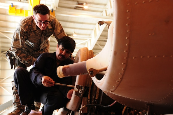 Master Sgt. Dave Penisten of the 440th Air Expeditionary Advisory Squadron verifies a compressor blade with 1st Lt. Ahmad Shah, Afghan Air Force maintainer at the AAF compound in Kabul, Afghanistan. Coalition advisers work daily at the AAF compound to instruct Afghan maintainers on the fine art of maintaining the Afghan Mi-17 and Mi-35 helicopters.  Sergeant Penisten is stationed at Royal Air Force Mildenhall, England. (U.S. Air Force photo by Senior Airmen Amber Williams)