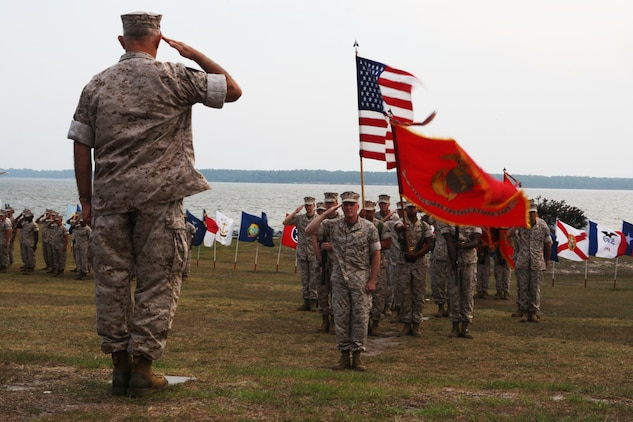 Lt. Gen. Dennis J. Hejlik, commanding general of Fleet Marine Forces Atlantic; Marine Corps Bases Atlantic and United States Marine Corps Forces Command (left), salutes Maj. Gen. Carl B. Jensen, commanding general of Marine Corps Installations East, during the MCIEAST change of command ceremony at the 2nd Marine Logistics Group Amphitheater, July 22. Jensen, who has served 36 years in the Marine Corps, relinquishes command of MCIEAST to Col. Thomas A. Gorry, brigadier general select, previously of the Command and Staff College, Marine Corps University.