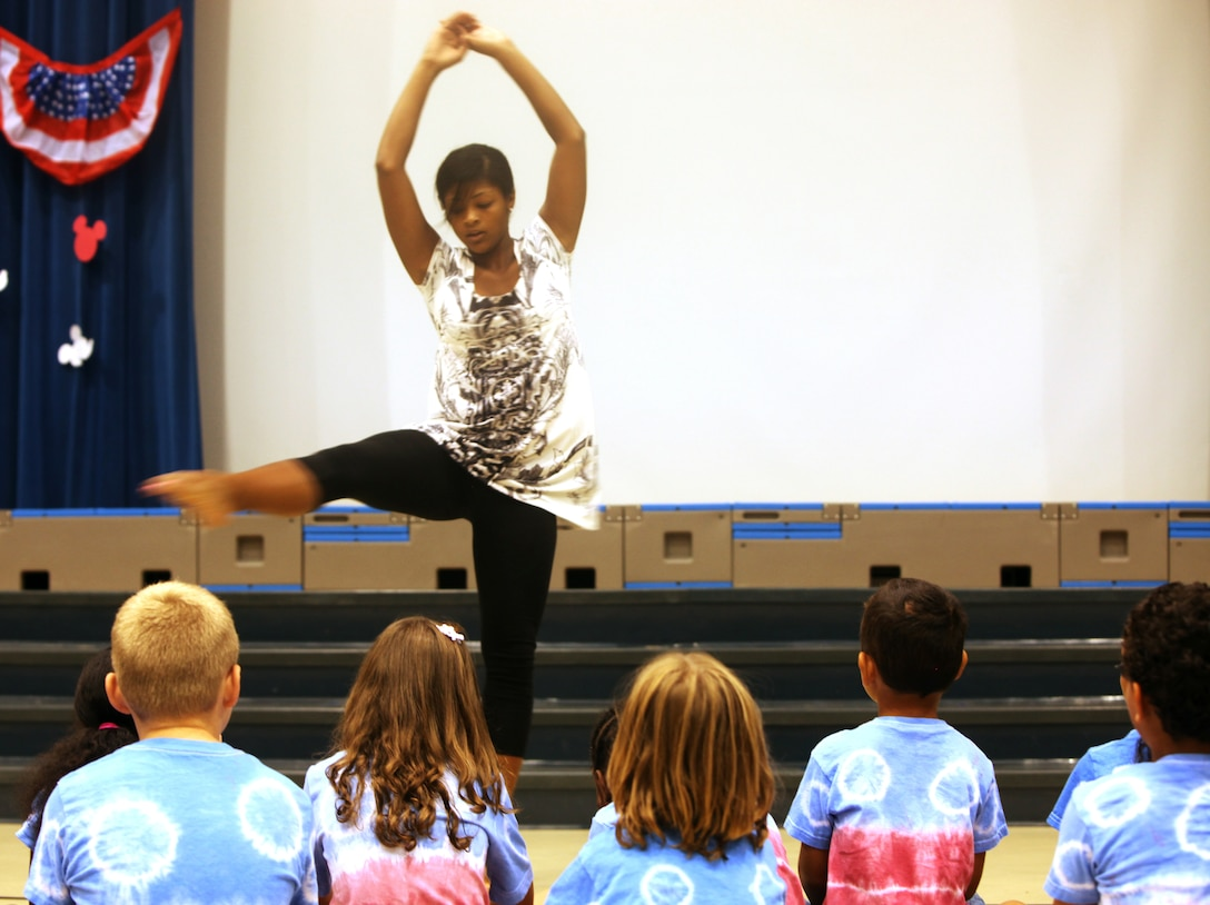 Costa Constantinou, a music specialist with Delalio Elementary School aboard Marine Corps Air Station New River, dances for the students of the Tarawa Terrace II Elementary School as part of the End of the Summer School Celebration, July 22.
