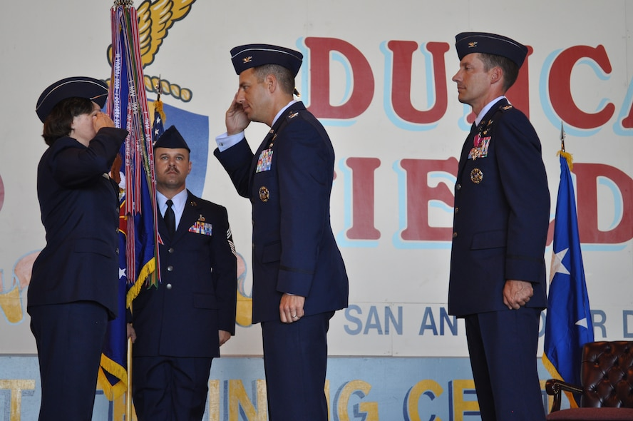 Colonel Paul A. Welch, incoming 688th Information Operations Wing commander, salutes Maj. Gen. Suzanne M. Vautrinot, 24th Air Force commander, after he takes command of the the wing in the Kelly Hangar, Port San Antonio, Texas, July 19. Also part of the ceremony for the wing headquartered at Lackland Air Force Base, Texas, are outgoing commander, Col. Robert J. Skinner, and Chief Master Sgt. Michael W. Whetsell, 688th IOW command chief. Colonel Welch took command of the wing after a year as the vice commander of the 67th Network Warfare Wing, also headquartered at Lackland. (U.S. Air Force Photo by Tech. Sgt. Scott McNabb)