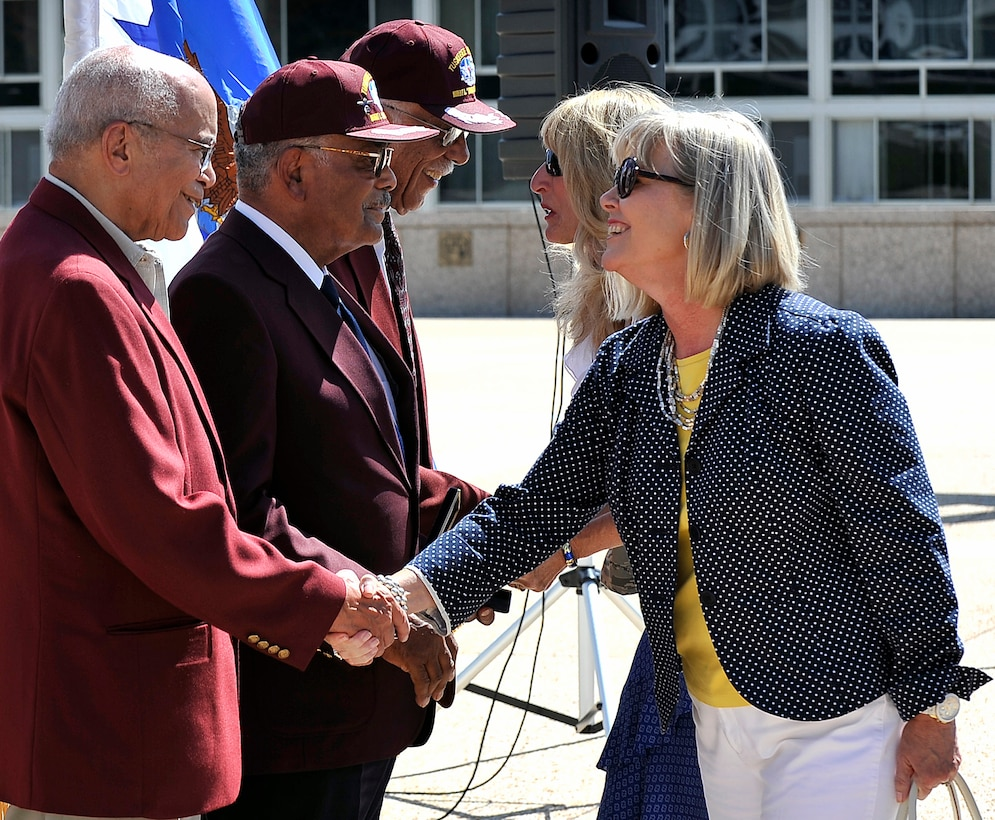 Suzie Schwartz and Paula Gould thank former Aviation Cadet Randy Edwards, former 2nd Lt. Franklin Macon and retired Capt. Sam Hunter, Jr. for their service to the United States during a ceremony at the Air Force Academy July 22, 2011. The Academy hosted the ceremony to present a replacement bronze Tuskegee Airman medal replica to Macon, whose original replica was stolen in a home burglary May 31. Schwartz is the wife of Air Force Chief of Staff Gen. Norton Schwartz, and Gould is the wife of Academy Superintendent Lt. Gen. Mike Gould. (U.S. Air Force photo/Ray McCoy)