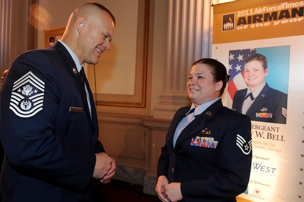 Chief Master Sgt. of the Air Force James A. Roy congratulates Staff Sgt. Lindsay Bell July 21, 2011, in Washington, D.C. Bell, assigned to the 31st Intelligence Squadron at Fort Gordon, Ga., is the 2011 Air Force Times Airman of the Year, and was honored at the Military Times Service Member of the Year Awards Ceremony in the House of Representatives' Cannon Building. (U.S. Air Force photo/Scott M. Ash)