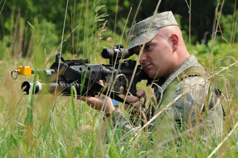 Providing Cover: Senior Airman Tyson Pierce, a fire team member with the 155th Security Forces Squadron, keeps lookout during a field patrol exercise at Camp Ashland, Neb., June 6. The members of the 155th SFS performed a field training training exercise during their annual training to conduct combat skills training