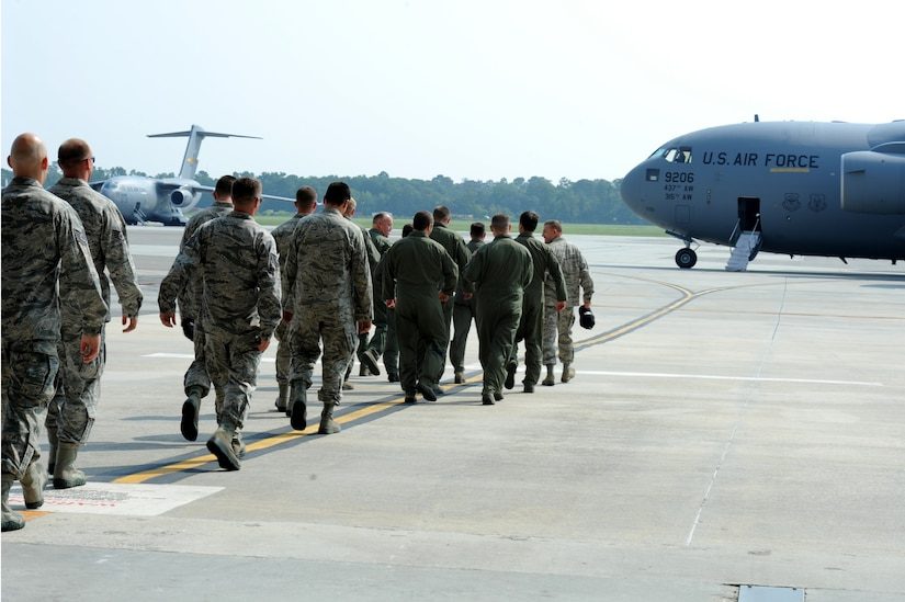 Team Charleston heads to the C-17 aircraft that will fly them to the Air Mobility Command 2011 Rodeo at Joint Base Lewis-McCord, Wash., July 22.  (U.S. Air Force photo/ Staff Sgt. Nicole Mickle)  (Released