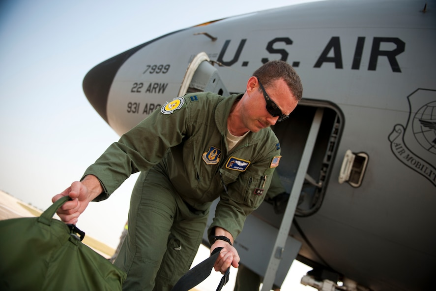 Capt. Chris Kidd, a 90th Expeditionary Air Refueling Squadron pilot, loads equipment onto a KC-135R Stratotanker aircraft before a flight July 20, 2011, at Incirlik Air Base, Turkey. The 90th EARS, a total-force team consisting of nearly 100 active-duty, Reserve and Air National Guard Airmen, conducts air-to-air refuels to C-17 Globemaster IIIs and C-5 Galaxies coming in and out of the area of operations. (U.S. Air Force photo by Tech. Sgt. Michael B. Keller/Released)