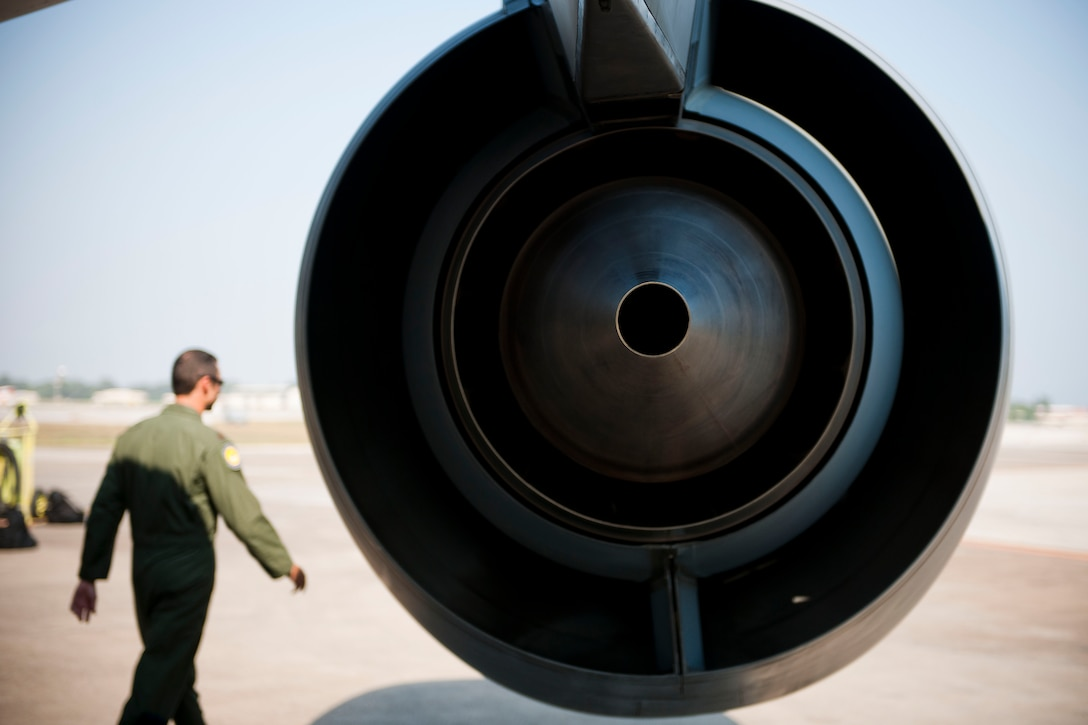 Maj. Trey Forrest, a 90th Expeditionary Air Refueling Squadron pilot, inspects a KC-135R Stratotanker aircraft before a flight July 20, 2011, at Incirlik Air Base, Turkey. The 90th EARS, a total-force team consisting of nearly 100 active-duty, Reserve and Air National Guard Airmen, conducts air-to-air refuels to C-17 Globemaster IIIs and C-5 Galaxies coming in and out of the area of operations. (U.S. Air Force photo by Tech. Sgt. Michael B. Keller/Released)