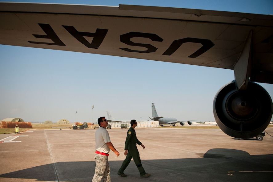 Maj. Trey Forrest, right, and Tech. Sgt. Michael Dymnioski, from the 90th Expeditionary Air Refueling Squadron, inspect a KC-135R Stratotanker aircraft before a flight July 20, 2011, at Incirlik Air Base, Turkey. The 90th EARS, a total-force team consisting of nearly 100 active-duty, Reserve and Air National Guard Airmen, conducts air-to-air refuels to C-17 Globemaster IIIs and C-5 Galaxies coming in and out of the area of operations. (U.S. Air Force photo by Tech. Sgt. Michael B. Keller/Released)