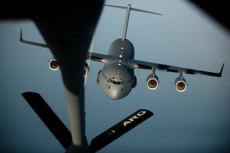 A C-17 Globemaster III aircraft approaches a 90th Expeditionary Air Refueling Squadron KC-135R Stratotanker aircraft during an air refueling training mission July 20, 2011, over the Black Sea north of Turkey. The 90th EARS, a total-force team consisting of nearly 100 active-duty, Reserve and Air National Guard Airmen, conducts air-to-air refuels to C-17 Globemaster IIIs and C-5 Galaxies coming in and out of the area of operations. (U.S. Air Force photo by Tech. Sgt. Michael B. Keller/Released)