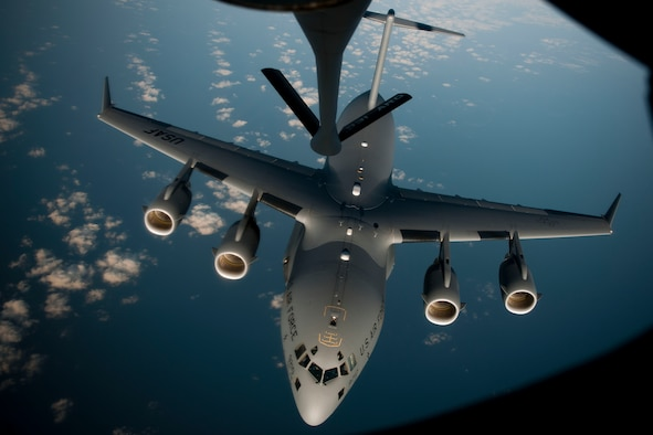 A C-17 Globemaster III aircraft disconnects from a 90th Expeditionary Air Refueling Squadron KC-135R Stratotanker aircraft during an air refueling training mission July 20, 2011, over the Black Sea north of Turkey. The 90th EARS, a total-force team consisting of nearly 100 active-duty, Reserve and Air National Guard Airmen, conducts air-to-air refuels to C-17 Globemaster IIIs and C-5 Galaxies coming in and out of the area of operations. (U.S. Air Force photo by Tech. Sgt. Michael B. Keller/Released)