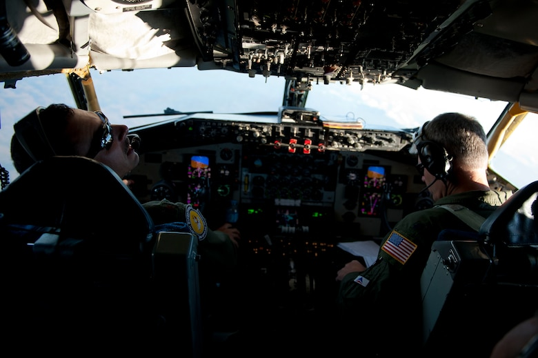 Maj. Trey Forrest, left, and Lt. Col. Barry Jones, 90th Expeditionary Air Refueling Squadron pilots, fly a KC-135R Stratotanker aircraft July 20, 2011, over Turkey. The 90th EARS, a total-force team consisting of nearly 100 active-duty, Reserve and Air National Guard Airmen, conducts air-to-air refuels to C-17 Globemaster IIIs and C-5 Galaxies coming in and out of the area of operations. (U.S. Air Force photo by Tech. Sgt. Michael B. Keller/Released)
