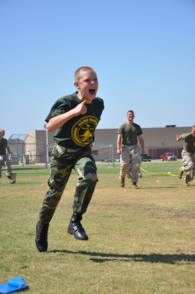 Gung-ho little marine goes for it as the big Marine mentoring him shouts encouragement.