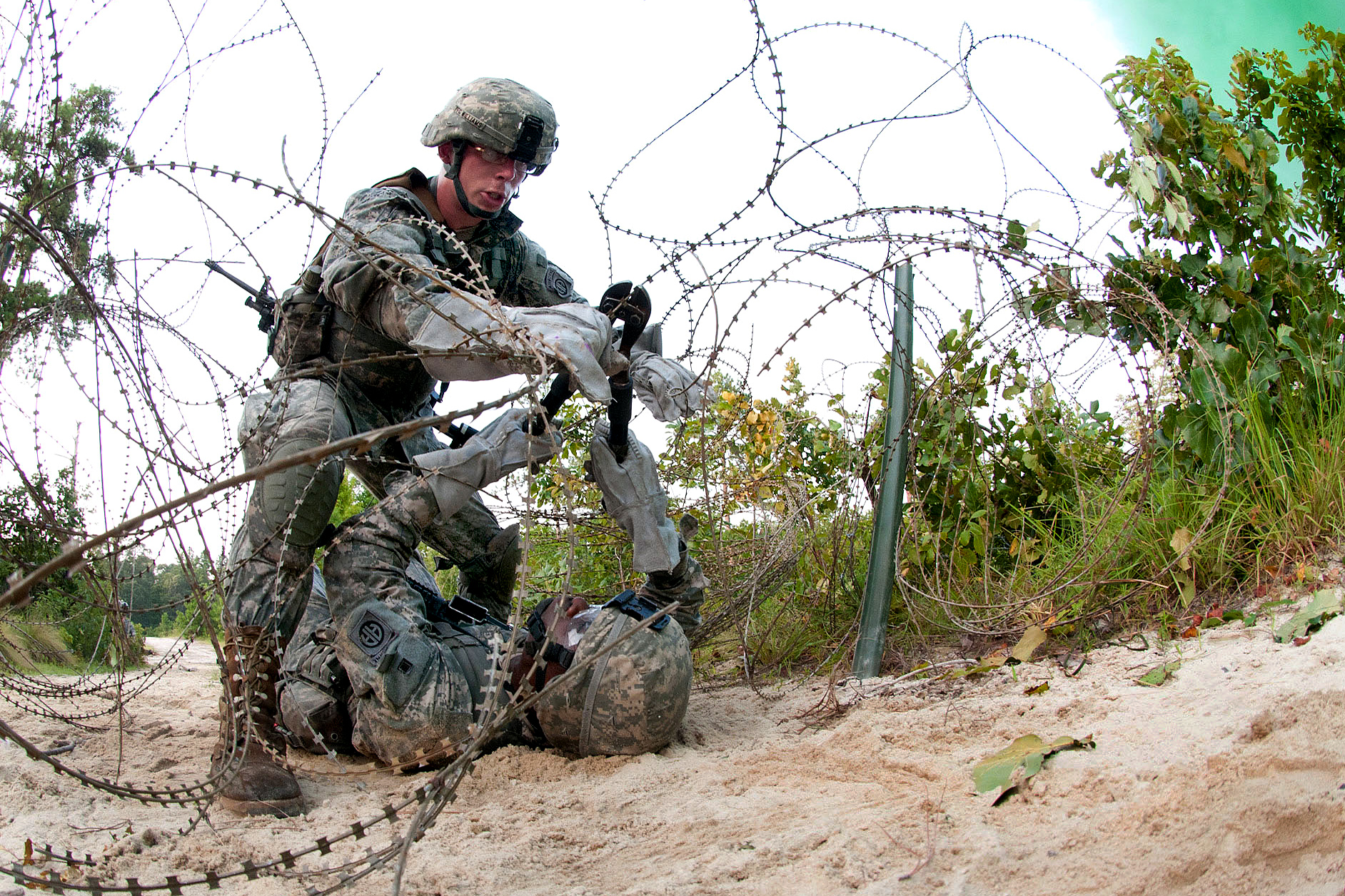 army combat engineers cut through a wire obstacle during a live fire training exercise on