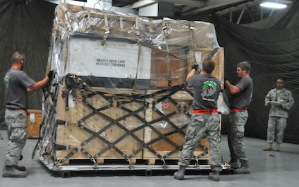 Airmen secure a pallet during a pallet build-up competition, July 25, 2011, at Joint Base Lewis-McChord, Wash. The event was part of Air Mobility Rodeo 2011, a biennial international competition that focuses on mission readiness, featuring airdrops, aerial refueling and other events that showcase the skills of mobility crews from around the world. (U.S. Air Force photo/Airman 1st Class Jared Trimarchi)