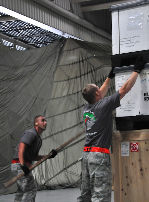 Airmen ensure their pallet meets the height requirement of a specific air frame, July 25, 2011, at Joint Base Lewis-McChord, Wash., during a pallet build-up competition. The event was part of Air Mobility Rodeo 2011, a biennial international competition that focuses on mission readiness, featuring airdrops, aerial refueling and other events that showcase the skills of mobility crews from around the world. (U.S. Air Force photo/Airman 1st Class Jared Trimarchi)