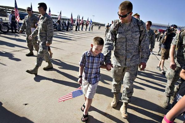 Master Sgt. Michael Condon walks with his son Gavin Condon after returning from a six-month deployment in Afghanistan. The 729th Air Control Squadron of the U.S. Air Force returned home to Hill Air Force Base in Layton on Wednesday, July 20, 2011.