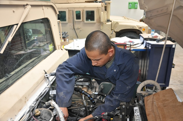 Corporal Miguel Verdin, a 21-year-old heavy mobile equipment mechanic from Aurora, Ore., preps an M1114 Humvee prior into installing a new alternator July 26 at the Strip 8 facility aboard the Yermo Annex of Marine Corps Logistics Base Barstow.