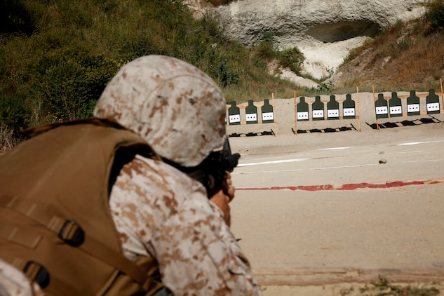 A Marine with the 15th Marine Expeditionary Unit Command Element adjusts his battle-sight zero, as a part of a familiarization fire range conducted on Camp Pendleton, July 26-27.