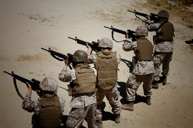 Marines with the 15th Marine Expeditionary Unit (MEU) Command Element conduct a Combat Marksmanship Program, as a part of a familiarization fire range conducted on Camp Pendleton, July 26-27.