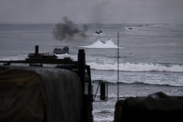 Amphibious Assault Vehicles splash into the shoreline of Camp Pendleton's Red Beach as part of a training exercise, July 26. More than 550 Marines from 4th Assault Amphibian Battalion reserve unit came to base as part of their annual training exercises to practice amphibious assault tactics.