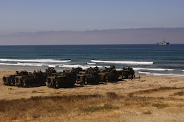 The marine layer floats heavily over Camp Pendleton's Red Beach horizon as Amphibious Assault Vehicles prepare to splash into the ocean to practice amphibious assault tactics, July 26. More than 550 Marines from 4th Assault Amphibian Battalion reserve unit came to base as part of their annual training exercises.