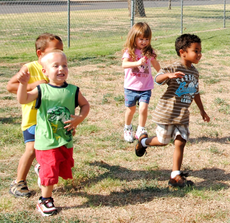 "Children at the Vance AFB Child Development Center participate in the ""Fit Families"" program taught by the staff of the Health and Wellness Center. The program combines healthy eating and exercise, which for the younger participants, means getting outside and having fun. (U.S. Air Force photo/ Jessica Gibson)"