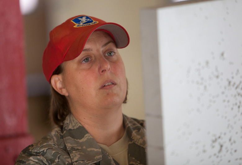 Tech. Sgt. Renae Bounouas prepares targets for students qualifying with M16-A2 rifles July 16, 2011, at the combat arms training and maintenance center Joint Base Andrews, Md. Tech. Sgt. Renae Bounouas is the 113th Security Forces CATM NCO in charge (U.S. Air Force photos/Tech Sgt. Gareth Buckland/Released)
