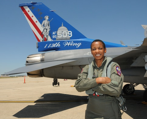 Rep. Donna Edwards stands in front of an F-16C Fighting Falcon prior to her flight aboard the jet with the 121st Fighter Squadron, 113th Wing, Joint Base Andrews, Md., June 29, 2011. This was the congresswoman's first time aboard a fighter jet, a life-long desire she held since she was a young daughter of an Air Force veteran. (U.S. Air Force photo/Tech Sgt. Craig Clapper/Released)