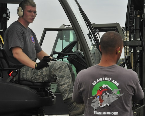 Staff Sgt. Chris Lenane, 62nd Aerial Port Squadron Rodeo team member, prepares to start the 10K forklift obstacle course competition July 25, 2011, at Joint Base Lewis-McChord. The event was part of Air Mobility Rodeo 2011, a biennial international competition that focuses on mission readiness, featuring airdrops, aerial refueling and other events that showcase the skills of mobility crews from around the world. (U.S. Air Force Photo/Staff Sgt. Frances Kriss)