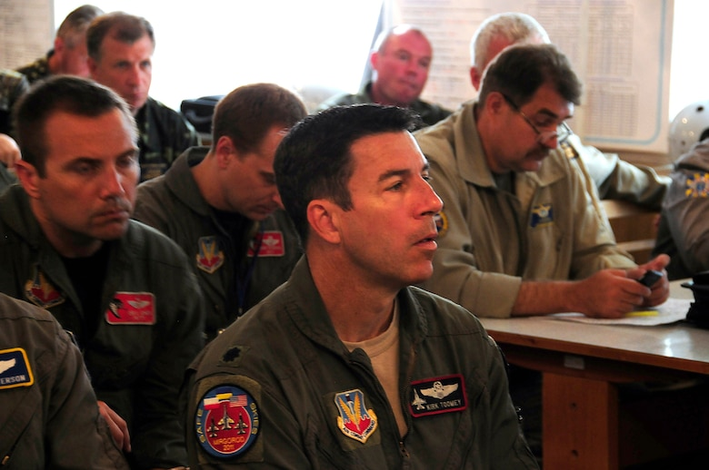 Lt. Col. Kirk Toomey of the California Air National Guard sits in a planning meeting before the launch of an intercept mission during SAFE SKIES 2011.  SAFE SKIES 2011 is a military-to-military exchange between airmen from the U.S., Ukraine and Poland to enhance airspace security over the Ukraine and Poland in preparation for EURO 2012, the European soccer championship games. (U. S. Air Force photo/Tech. Sgt. Charles Vaughn)